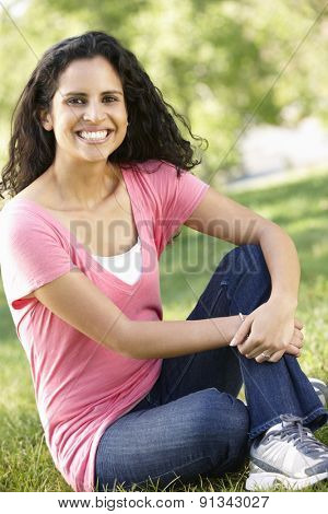 Young Hispanic Woman Relaxing In Park