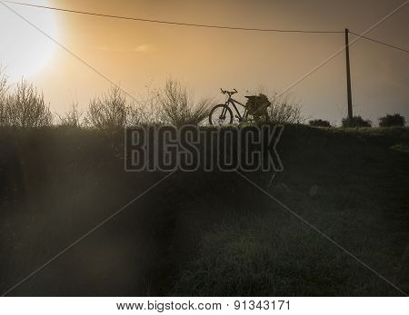 silhouette of a bike at sunset