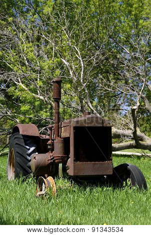 Old, old tractor parked in the grass