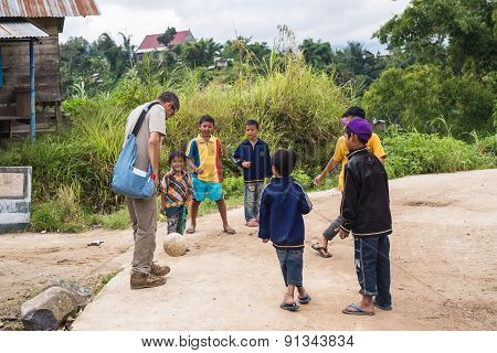 Children Playing Football With Adult Man