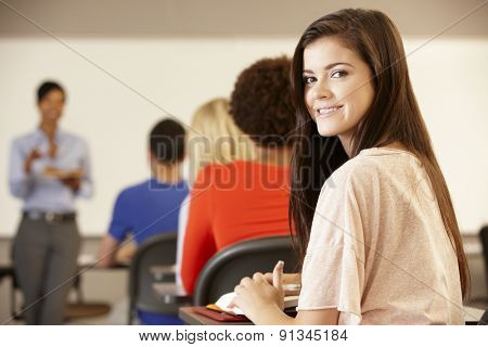Teenage girl in class smiling to camera