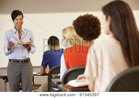 African American teacher teaching at front of class