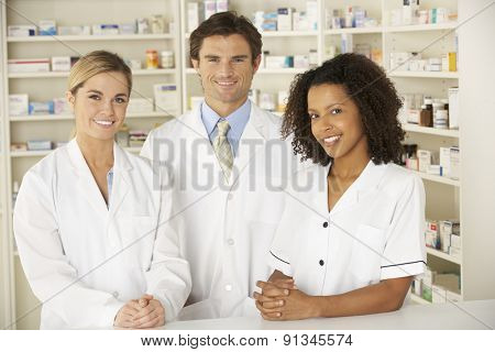 Nurse and pharmacists working in pharmacy