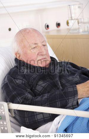 Senior man in hospital bed