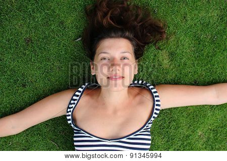 Beautiful girl on green grass