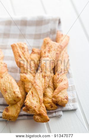 bread sticks with cheese on kitchen table
