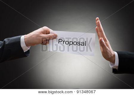 Close-up Of Man's Hand Refusing Proposal Sign