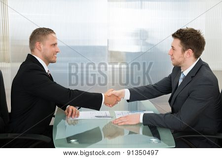 Two Businessman Shaking Each Other Hands