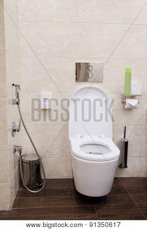 White ceramic toilet in bathroom