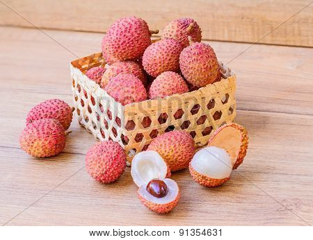 Fresh Lychee In Bamboo Basket On A Wooden Background