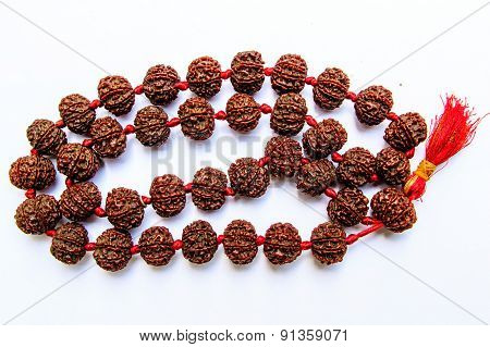 closeup of rudraksha garland compiled by eight faced beads