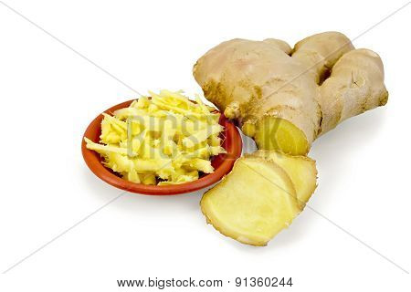 Ginger grated in bowl with root