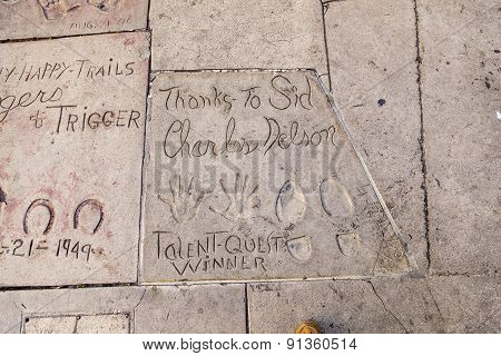 Handprints Of Charles Nelson In Hollywood Boulevard In The Concrete Of Chinese Theatre's Forecourt