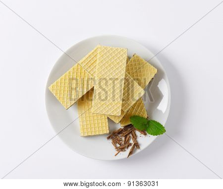 plate of chocolate wafers on white background