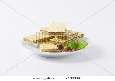 stack of chocolate wafers on white plate