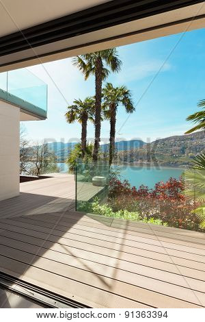 beautiful veranda overlooking the lake, view from interior