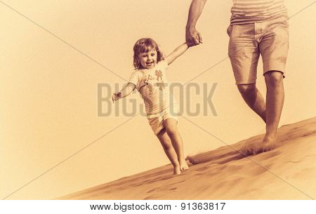 Running down the sand dunes