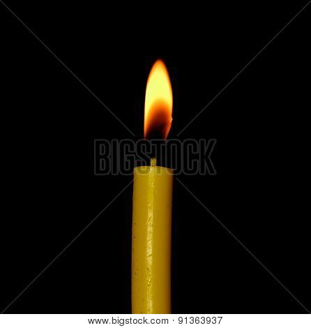 Candle Flame Closeup Isolated On Black Background