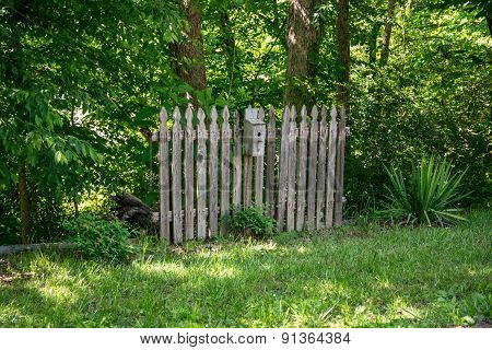 Rustic Fence with Birdhouse