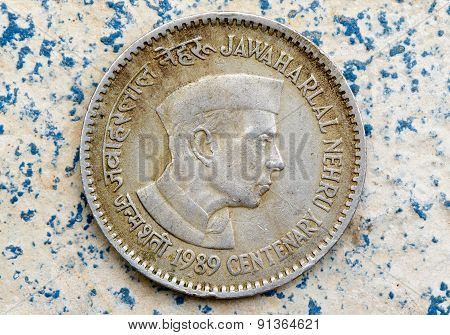 Vintage coin depicting India's first Prime Minister Jawaharlal Nehru