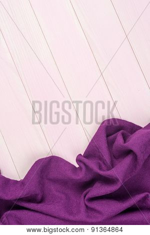 Purple Towel Over Pale Wooden Table