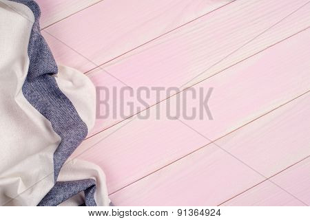 Blue Towel Over Pink Wood Table