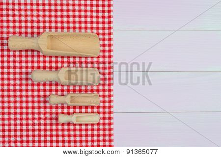 Wood Scoops On Red Gingham Towel