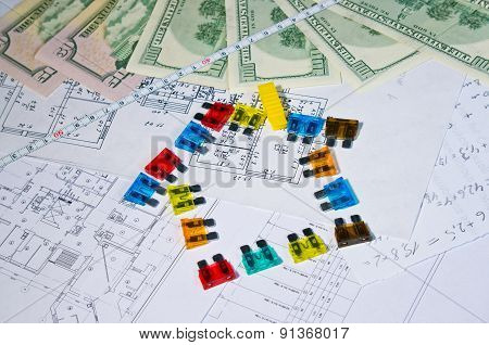 fuses and money on construction drawings