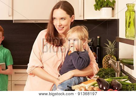 Mother And Child In The Kitchen