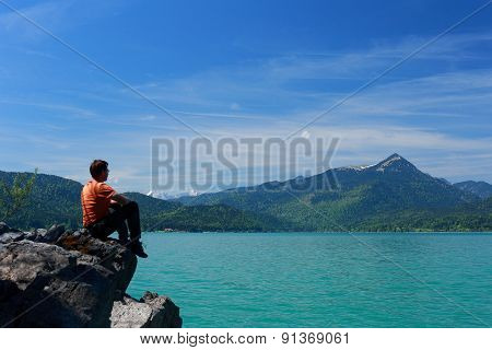 Man Is Sitting On Top