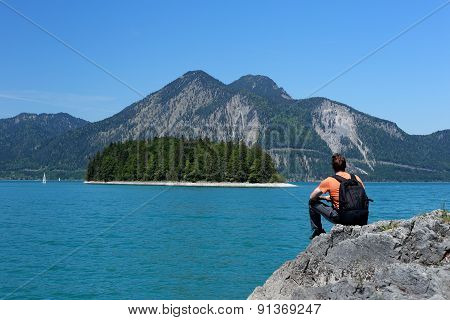 Backpacker Is Sitting