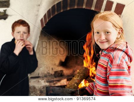 Boy And Girl Together By The Fireside