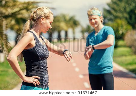 Two Runners Checked Results Of Run Distance