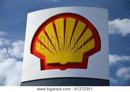sign of Shell against blue sky