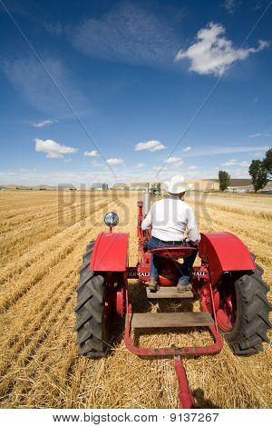 Man driving tractor.