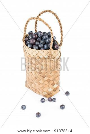 Wicker basket with Blueberries Isolate on white