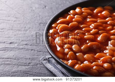Beans In Tomato Sauce In A Black Bowl