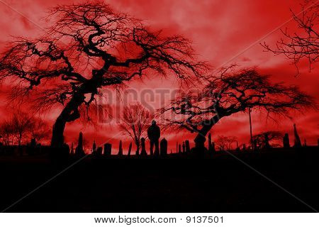 Scary pic of cemetery with hellfire sky