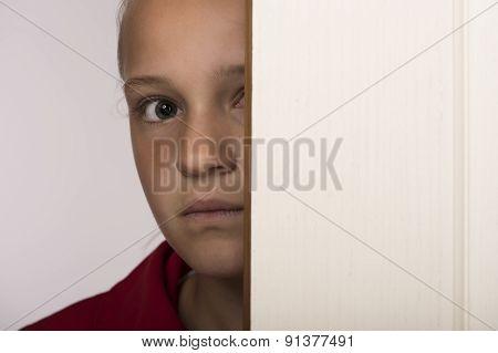 Girl behind door