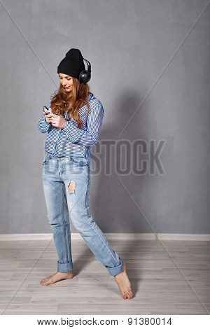 Hipster Girl Listening To Music On Headphones.