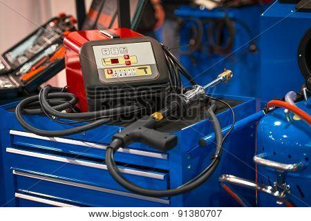 Modern welding gun on blue box