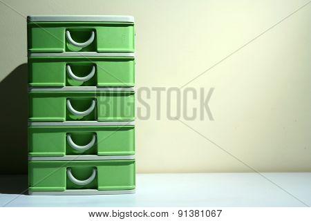 Green plastic organizer drawer