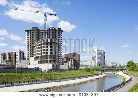 River In City And Construction Building Ashore