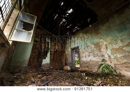 Dark room interior with damaged roof