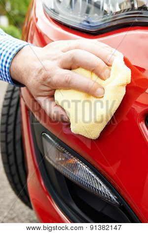 Close Up Of Hand Polishing Car Using Cloth