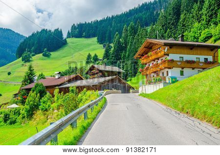 Typical alpine building oon green meadow, Austria