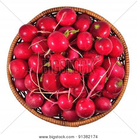 Red Radish In A Wicker Bowl On A White