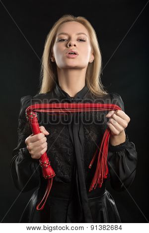 beautiful woman in biting red whip