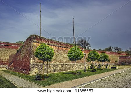 Medieval Fortified Walls And Ornamental Trees
