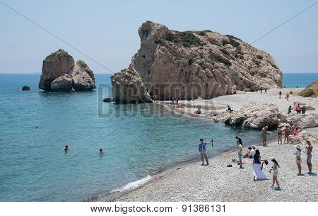 People Swimming And Walking At  Of The Rock Of Aphrodite Beach, Paphos, Cyprus.